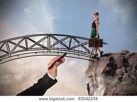 Woman crosses a bridge
