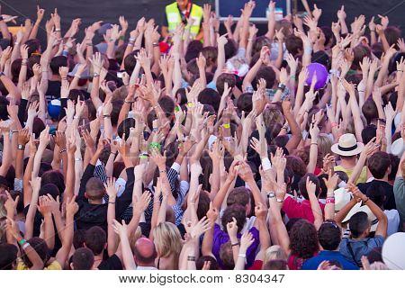 Crowd Holding Up Hands