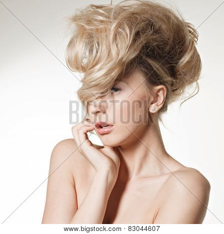 The Beautiful Young Girl With A Long Fair Hair Posing  In Studio.