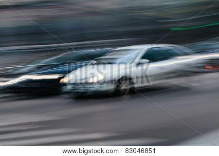 Cars In A Blurred City Scene
