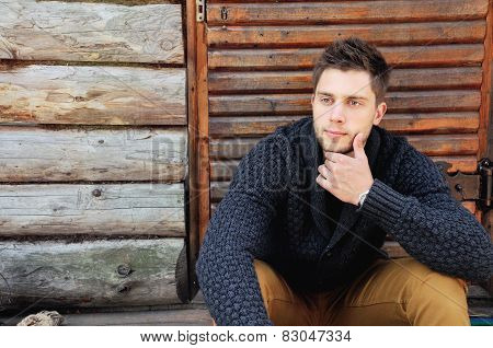 Young Handsome Fashionable Man By The Wooden Coutry House