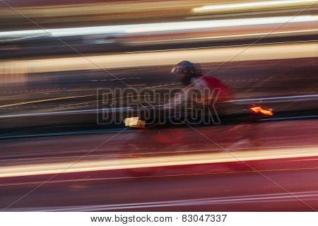 Motorbike In A Blurred City Scene