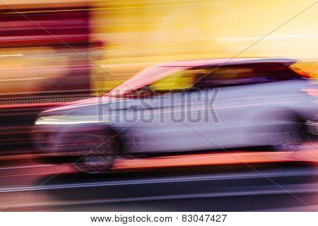 White Suv Car In A Blurred City Scene