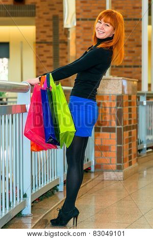 Happy Shopaholic In The Mall With Shopping Bags