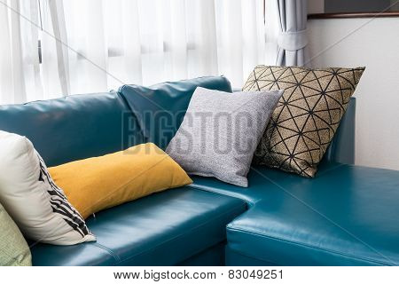 Modern Living Room With Green Sofa And Pillows At Home