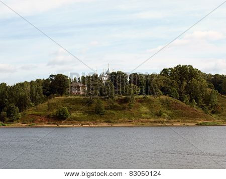 The Church and the house on a steep bank of the river