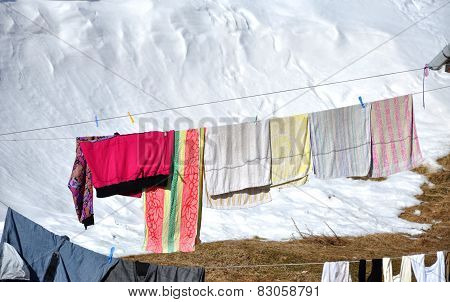 Hanging Laundry Drying On A Clothesline At Winter