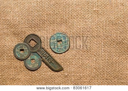 Ancient Chinese Bronze Coins On Old Cloth