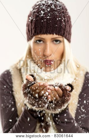 Cute Blonde Blowing Snowflakes