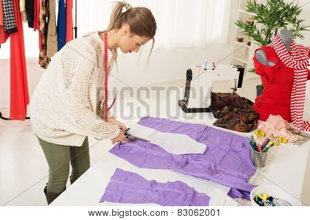 Female Tailor Cutting Material
