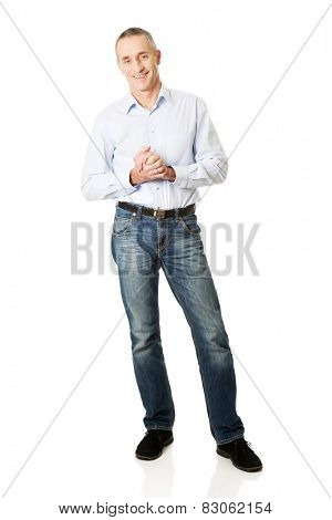 Handsome mature man with clenched hands.