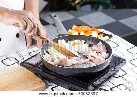 Chef Stir-fried Slice Of Pork In The Pan For Cooking Japanese Pork Curry