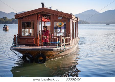 Chinese Wooden Recreation Boat Goes On The West Lake