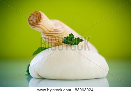 Yeast Dough With A Wooden Rolling Pin