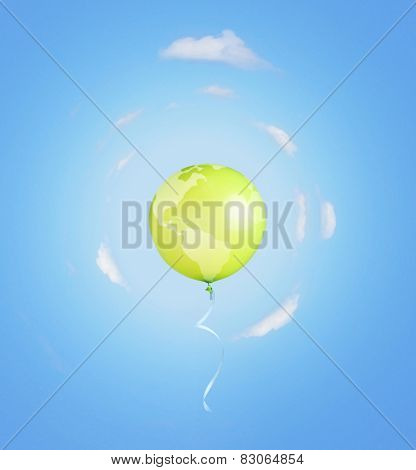 Green balloon like earth planet with ribbon flying into the sky.