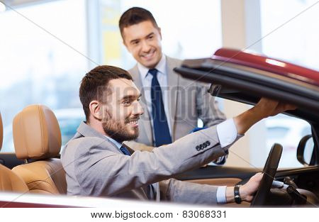 auto business, car sale, consumerism and people concept - happy man with car dealer in auto show or salon