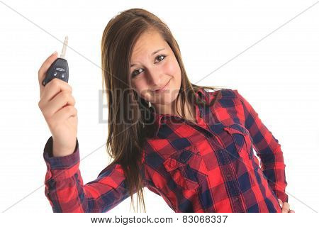 A teen holding key in front of a white background