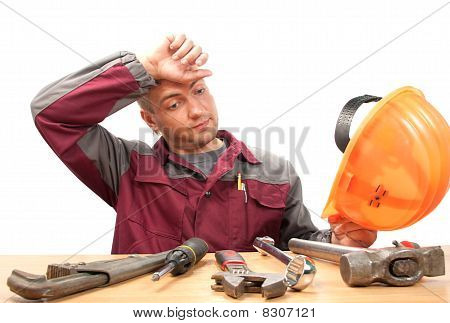 Tired Working Man With Tools