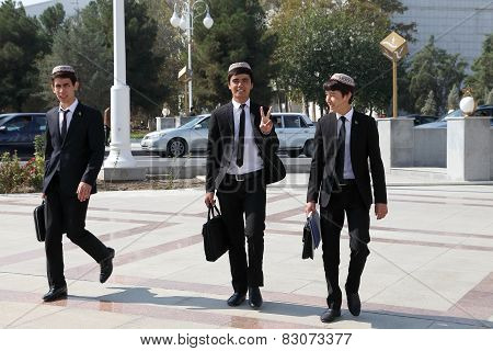 Ashgabad, Turkmenistan - October 10, 2014.  Group Of Cheerful Students In National Skullcaps