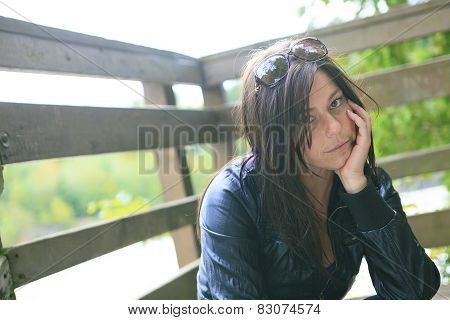 A 30 years old woman portrait sit on a seat