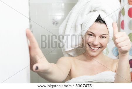 Shower woman. Happy smiling woman washing shoulder showering in