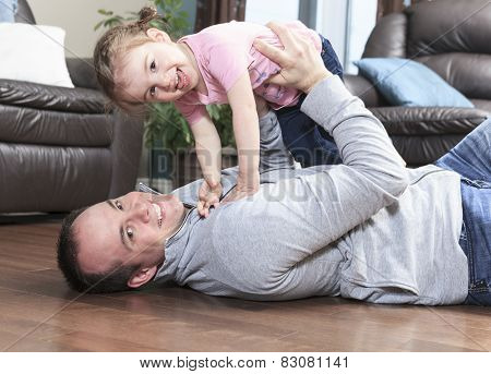 family, child and home concept - smiling parents and little girl