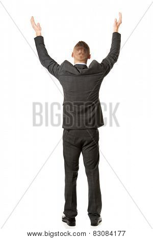 Happy businessman making presentation with both hands .