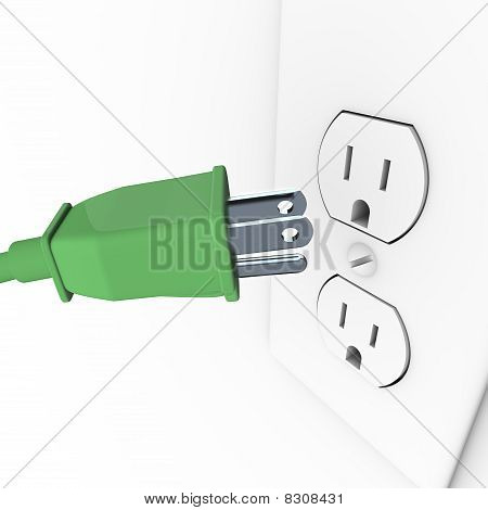 Green Electrical Plug Into Wall Outlet