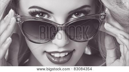 Seductive Woman Wearing Sunglasses