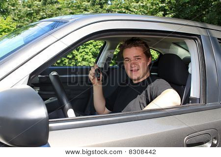 Teenage Male Showing Car Key Behind The Wheel