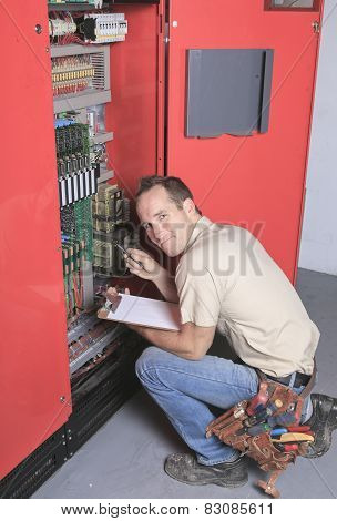 machinist worker technicians at work adjusting lift with spanner