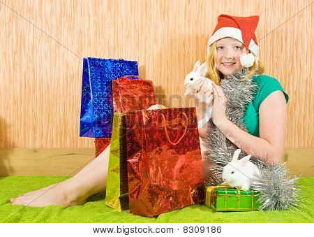 Girl  With Christmas Gifts And Rabbits