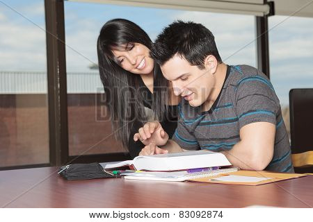 A 20 years old couple student studying.