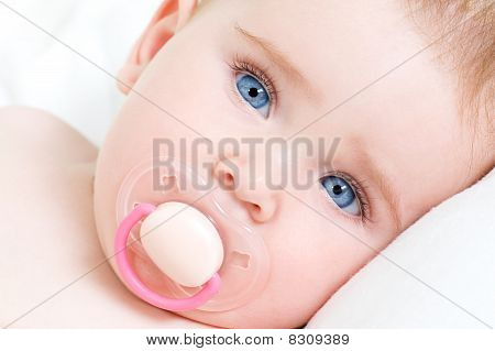 Face Of A Beautiful Newborn Girl With Blue Face