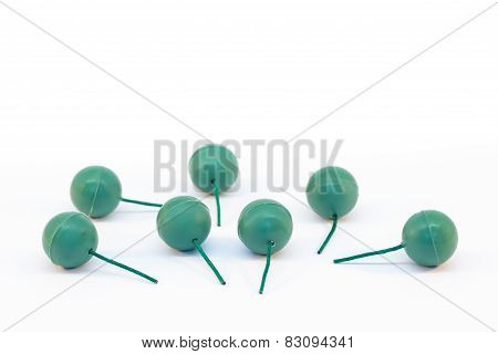 Green crackling balls as fireworks with fuses