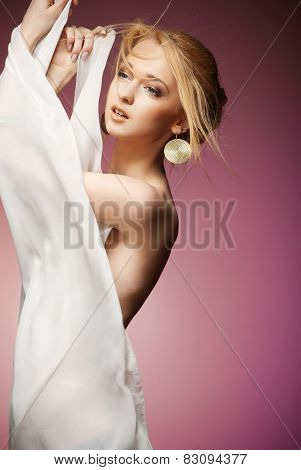 Beautiful woman with arms draped in white chiffon