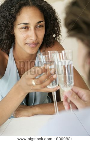 Adult couple toasting champagne glasses