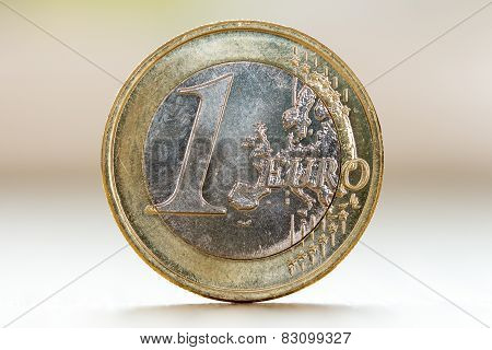 One Euro  Isolated On Blurry Background