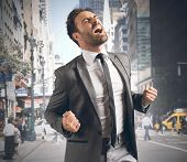 pic of scream  - Businessman screaming happy after reaching a goal - JPG