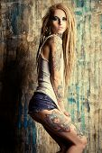 foto of denim jeans  - Modern girl with blonde dreadlocks - JPG