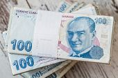 foto of turkish lira  - Bunch of Turkish Lira over white wooden background - JPG