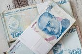 stock photo of turkish lira  - Bunch of Turkish Lira over white wooden background - JPG