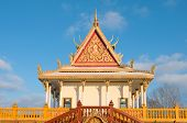 image of bannister  - colorful buddhist monastery outside Hampton Minnesota ornamented with gold leafing spire and balustrade near hampton minnesota - JPG