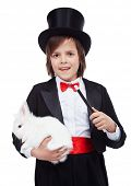 stock photo of magic-wand  - Young magician boy holding white rabbit and magic wand  - JPG
