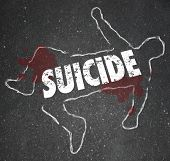 stock photo of suicide  - Suicide word written on a chalk outline of a dead body - JPG