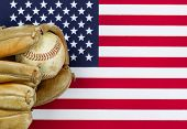 Постер, плакат: Worn Baseball Glove And Ball On American Flag