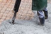 stock photo of street-rod  - Pouring cement during sidewalk upgrade at the street - JPG