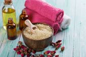 image of salt-bowl  - Spa setting with sea salt towel and aroma oil on aqua painted wooden boards - JPG