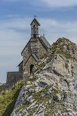 stock photo of bavarian alps  - Small chapel on a mountain in the Bavarian alps - JPG