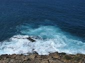 picture of breaker  - The rocks and the wave breakers of the Atlantic ocean at  Punto de Paso Chico on the island Fuerteventura in Spain - JPG